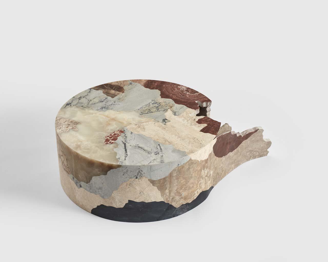 Escultura tallada a mano con distintas piedras del ande peruano. Handcarved sculpture with different rocks from Peruvian Andes.